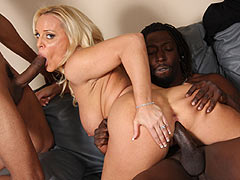 busty blonde cougar Alexis Golden gets double banged by blacks