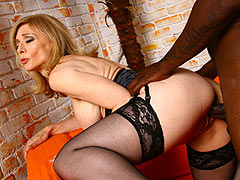 Busty mature Nina Hartley goes black in sexy black Lingerie