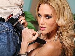 Inked and big boobed Sarah Jessie sucking and riding on a black cock