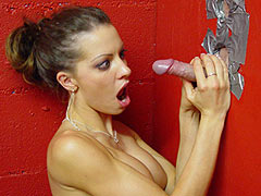Vanessa Lane sucking off a white Cock through a Gloryhole