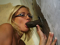 Spectacled blonde Adrian Olsen taking a black gloryhole cock