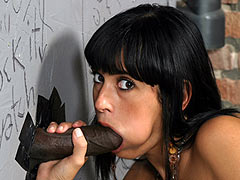Desani Lezian satisfying a Stranger at a Gloryhole