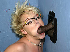 Missy Monroe draining a black Dong at a Gloryhole