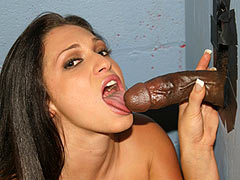 Sassy Valour sucking a monstrous black cock at a gloryhole